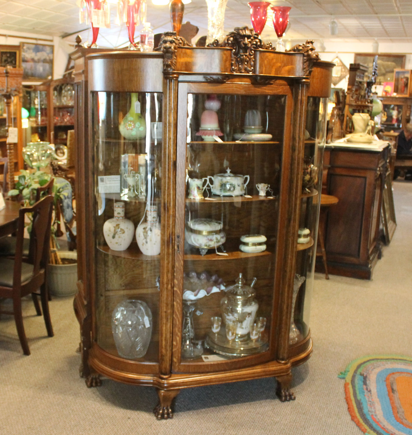 Oak China Curio Cabinet With Detailed Lions Heads Sold