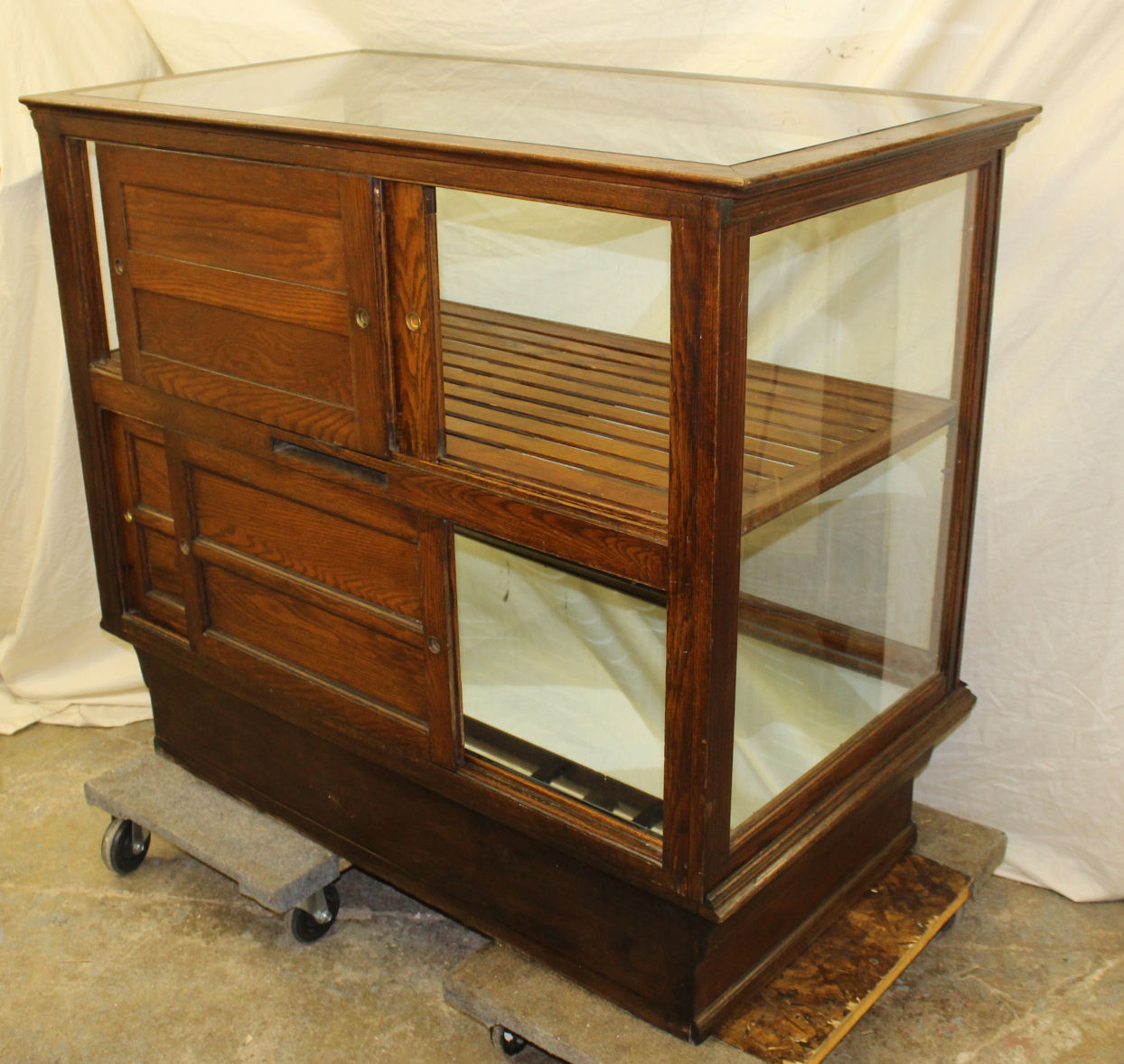 There is a brass label of the maker of the cabinet on the inside that reads  Yesbera Toledo Ohio. Measures 48″ wide, 26 1/2″ Depth and 42 1/2″ Height. - Bargain John's Antiques » Blog Archive Antique Oak Cigar Tobacco